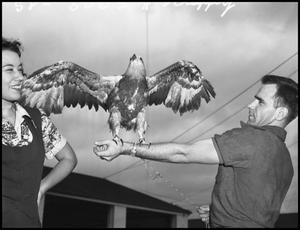 "Primary view of object titled '[Woman and Man with Eagle named ""Scrappy""]'."