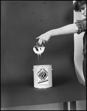 Primary view of object titled '[Female Dips a Pretzel into a Fineline Graphics Gloss Container #2, December 20, 1981]'.