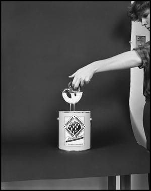 Primary view of object titled '[Female Dips a Pretzel into a Fineline Graphics Gloss Container #6, December 20, 1981]'.