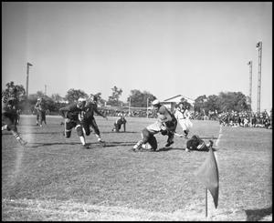 Primary view of object titled 'North Texas State Teachers College vs. Commerce Football Game in Action, 1939]'.