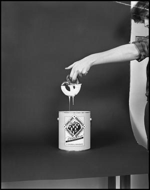 Primary view of object titled '[Female Dips a Pretzel into a Fineline Graphics Gloss Container #5, December 20, 1981]'.