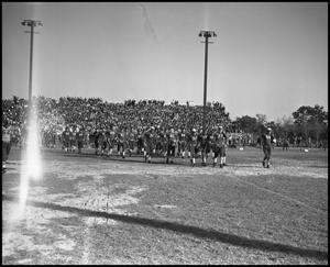 Primary view of object titled '[Football Players Walking onto the Field during a Game, 1939]'.