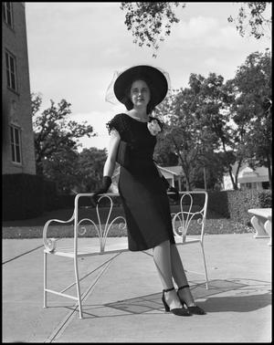 Primary view of object titled '[Female Student in a Black Dress Posing next to bench]'.