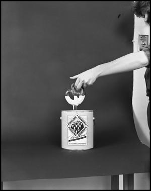 Primary view of object titled '[Female Dips a Pretzel into a Fineline Graphics Gloss Container #3, December 20, 1981]'.