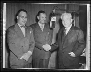 Primary view of object titled '[Three men in a radio studio]'.