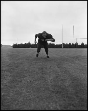Primary view of object titled '[North Texas State University Jersey No. 25 Football Player Running Low #2, September 1962]'.