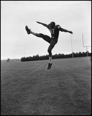 Primary view of object titled '[Football Player No. 87 in a Kicking Position Midair, September 1962]'.