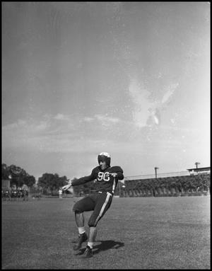 Primary view of object titled '[Football Player No. 90 on the Field during a Game]'.