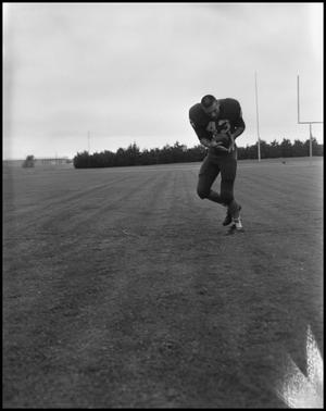 Primary view of object titled '[Football Player No. 43 Clutching a Football, September 1962]'.