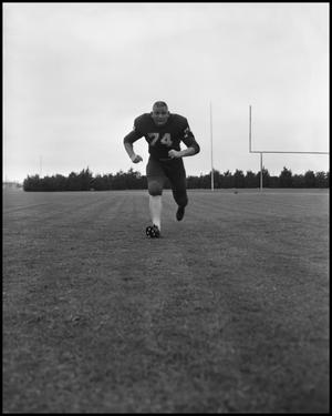 Primary view of object titled '[North Texas State University Jersey No. 74 Football Player Running, September 1962]'.