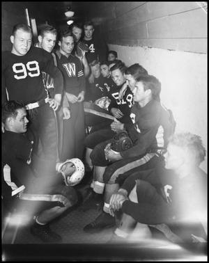 Primary view of object titled '[Football Players in Locker Room]'.