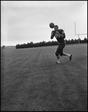 Primary view of object titled '[Football Player No. 84 Catching a Football, September 1962]'.