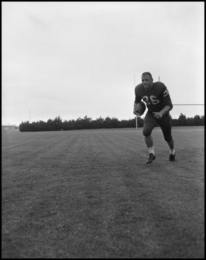 Primary view of object titled '[Football Player No. 36 Running with a Football, September 1962]'.