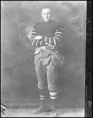 Primary view of object titled '[Football Player Posing for a Photograph]'.