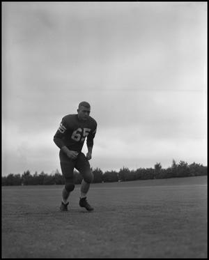 Primary view of object titled '[North Texas State University Jersey No. 65 Football Player, September 1962]'.