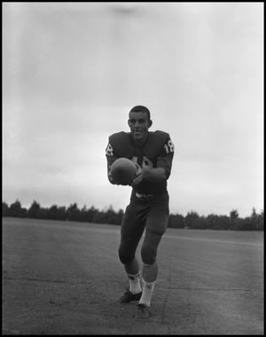 Primary view of object titled 'Football Player No. 18 Clutching a Football, September 1962]'.