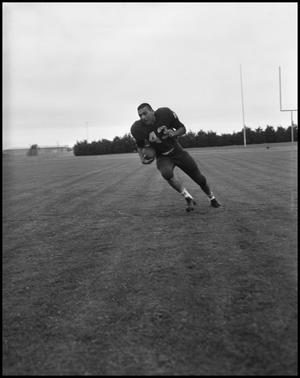 Primary view of object titled '[Football Player No. 43 Running with a Football, September 1962]'.