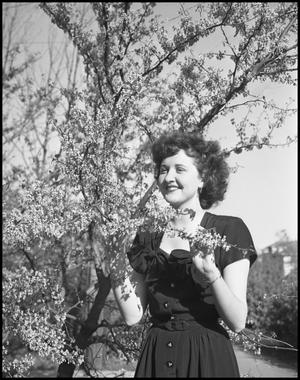 Primary view of object titled '[Mary B. Friend with tree]'.