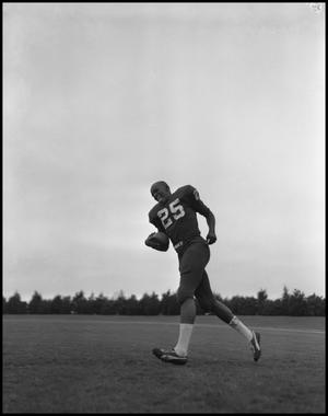 Primary view of object titled '[North Texas State University Jersey No. 25 Football Player, September 1962]'.