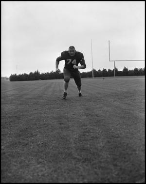 Primary view of object titled '[North Texas State University Jersey No. 74 Football Player, September 1962]'.