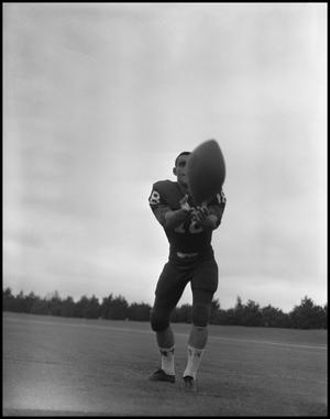 Primary view of object titled '[North Texas State University Jersey No. 18 Football Player, September 1962]'.
