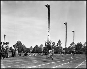 Primary view of object titled '[Track Member at Finish Line]'.