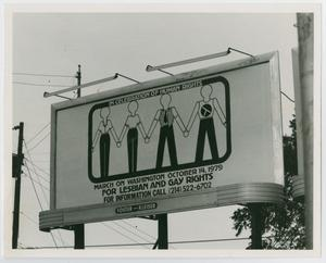 Angled sign, white banner with a drawing of four figures holding hands, framed by a a black line. Human rights title is at the top, more of it is at the bottom center.