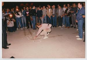Primary view of object titled '[Bill Nelson Drawing a Chalk Outline of a Body]'.