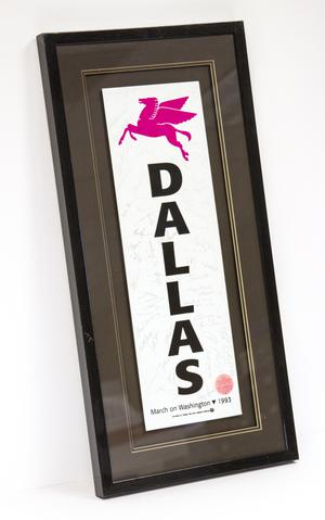 Framed long rectangle shaped poster of the 1993 March On Washington. A pink winged horse is at the top of the poster, and the word Dallas spelled longways down in bold black letters.