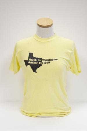 Light yellow t-shirt with black Texas shape and March on Washington title on it from the year 1979.
