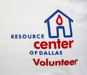 Close up of Blue house outline logo, with a red teardrop inside the house. The word Resource Center of Dallas Volunteer are in bold blue or red letters.