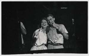 Primary view of object titled '[Couple enjoying sop sticks]'.