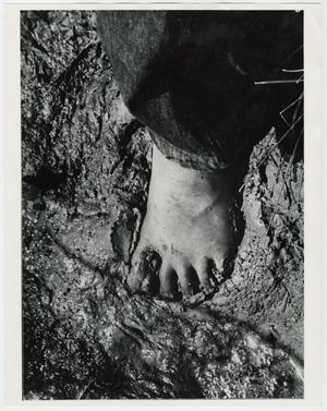 Primary view of object titled '[Jimmy Powell Squishing Mud between his Toes]'.