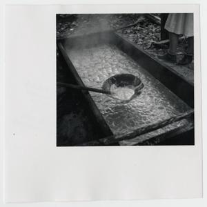 Primary view of object titled '[Stirring the Molasses]'.