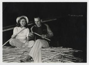 Primary view of object titled '[Couple Making Sop Sticks]'.