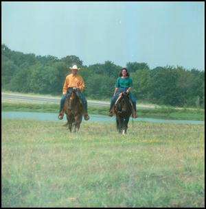 "Primary view of object titled '[Medium Shot of Two Riders on Horses, ""Phinney""]'."