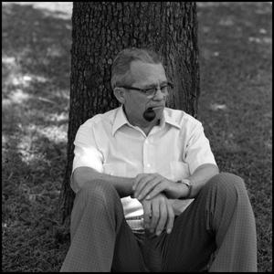 Primary view of object titled '[Dr. Wayne Adams Beneath Tree]'.