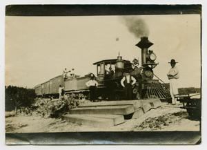 Primary view of object titled '[Men Standing by a Train]'.
