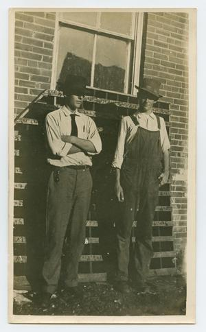 Primary view of object titled '[Two Men Standing Near a Window]'.