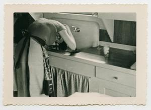 Primary view of object titled '[Woman Washing Her Hair in the Sink]'.