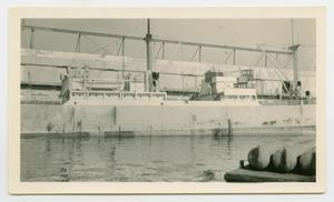 Primary view of object titled '[Large Ship Docked at Harbour]'.
