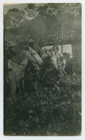Primary view of object titled '[Two Men at Camp With Horses]'.