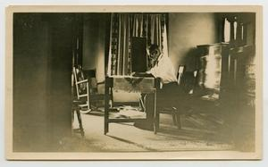 Primary view of object titled '[Man Sitting at a Desk]'.