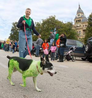 Primary view of object titled '[Sheri Broyles with dog in homecoming parade]'.
