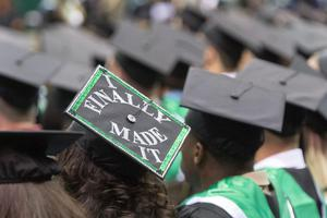 Primary view of object titled '[Decorated mortarboard at UNT Commencement]'.