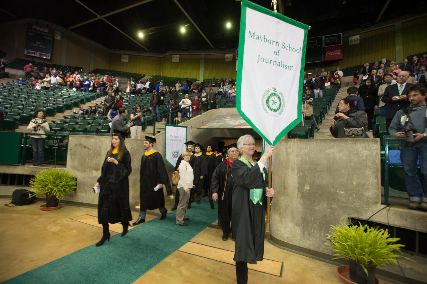 [Graduates entering Coliseum during UNT Fall Commencement]                                                                                                      [Sequence #]: 1 of 1