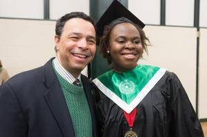 Primary view of object titled '[Neil Foote with student at UNT Commencement]'.