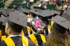 Primary view of object titled '[Caps at UNT Fall Commencement]'.