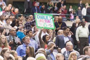 Primary view of object titled '[Girl holding sign at UNT Commencement]'.