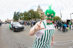Primary view of object titled '[Man in costume at UNT Homecoming parade]'.